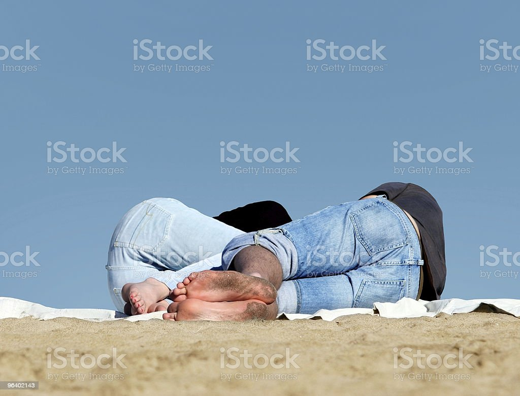 Couple sleeping on the beach - Royalty-free Adult Stock Photo