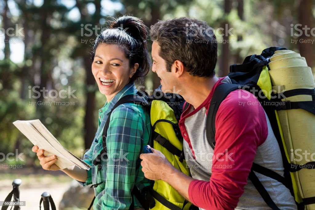 Couple smiling and hiking royalty-free stock photo