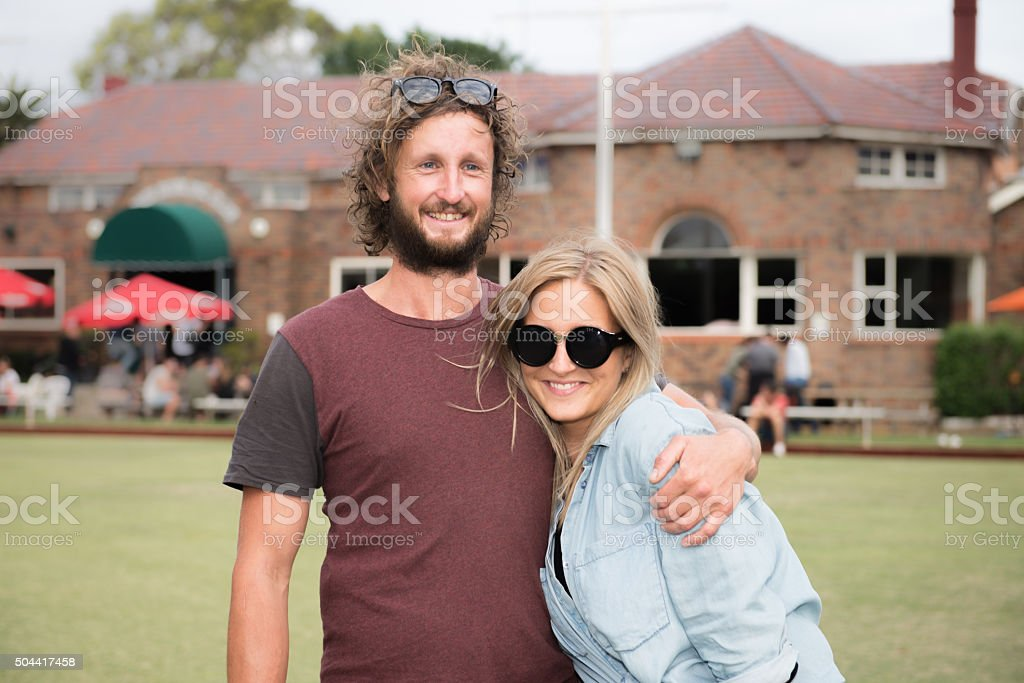 Couple smiling and hugging stock photo