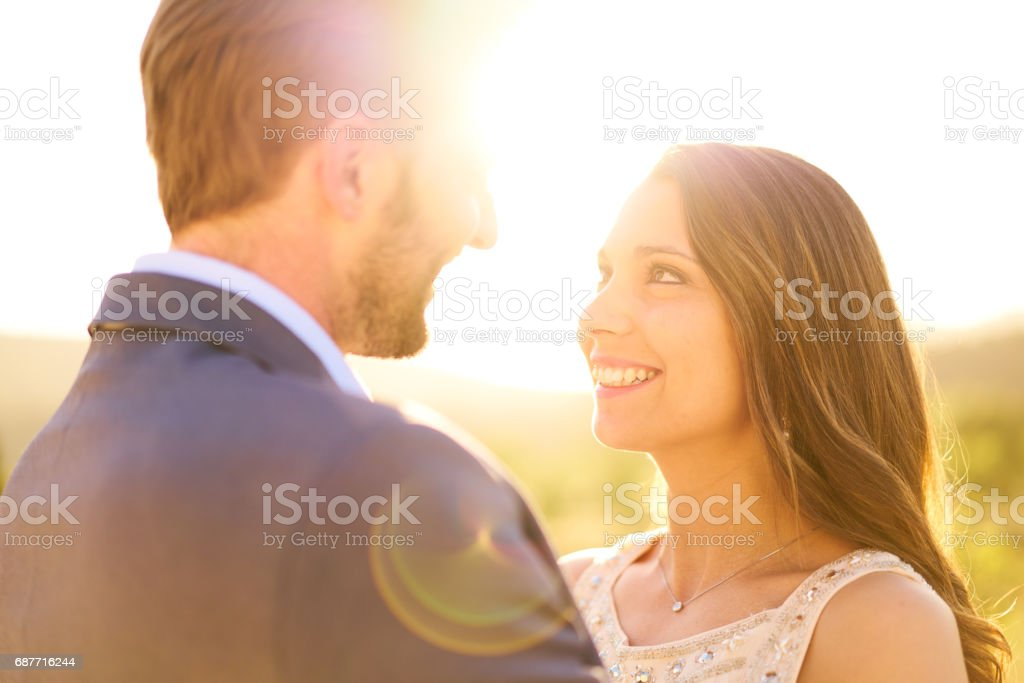 couple smiling at each other stock photo