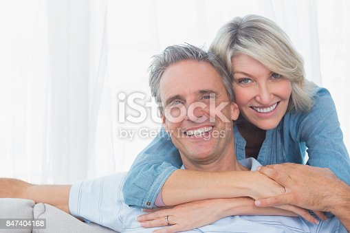 istock Couple smiling at the camera 847404168