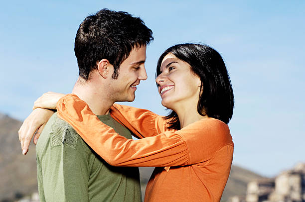 couple smiling each other stock photo