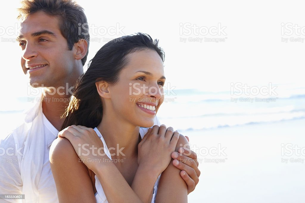 Couple smiling in different directions royalty-free stock photo