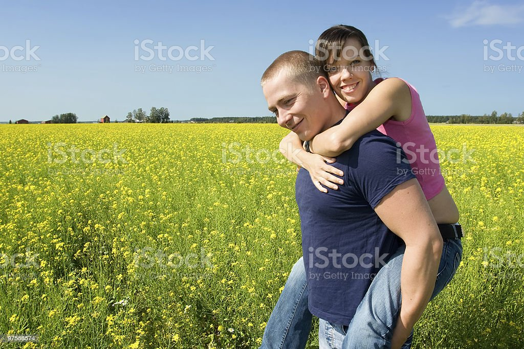 Couple smiling on a field royalty-free stock photo