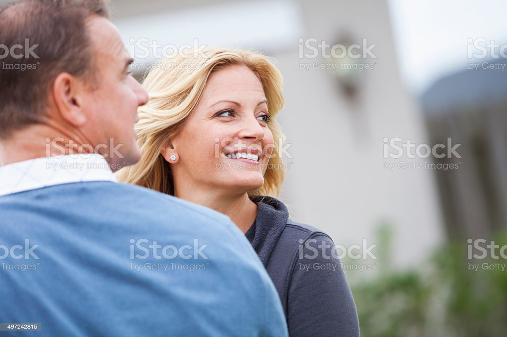 Couple smiling outdoors stock photo
