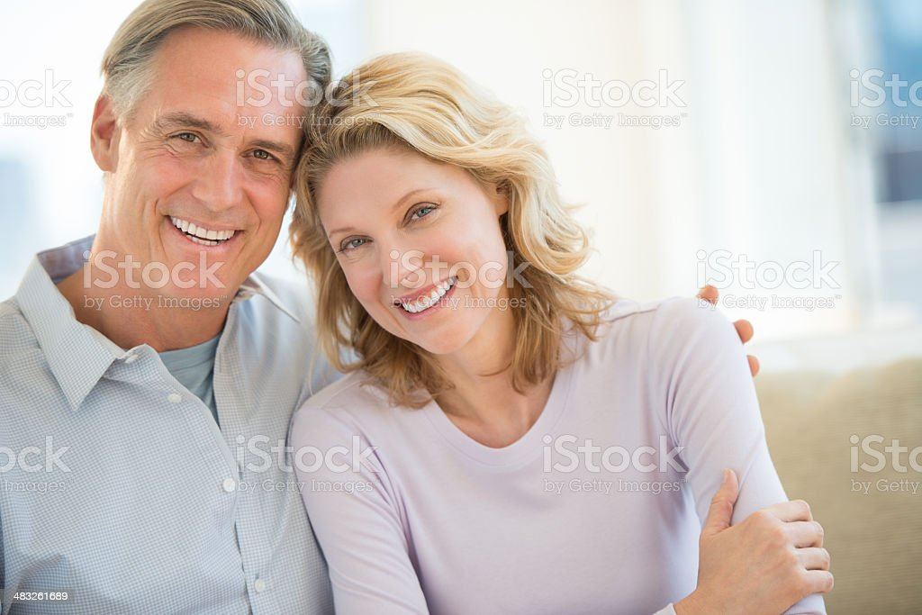 Couple Smiling Together At Home stock photo
