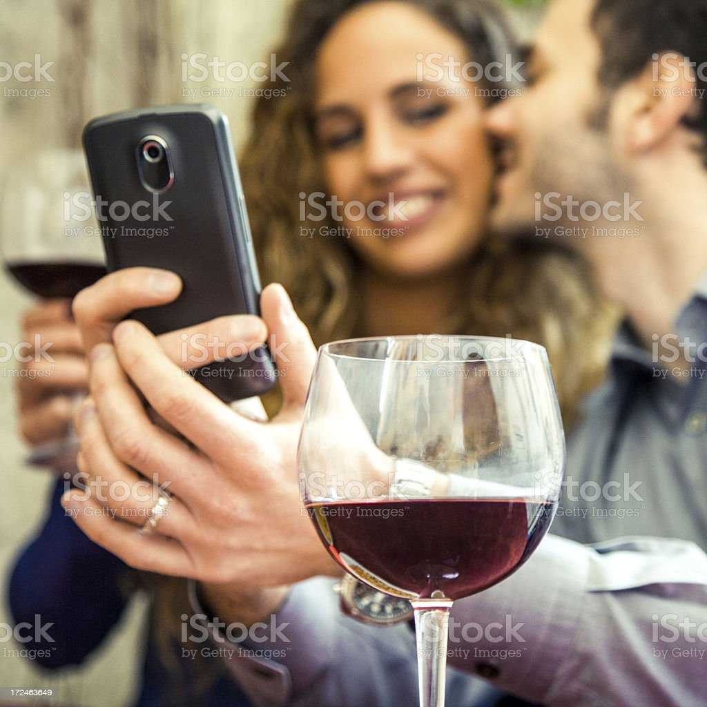 Couple smiling while posting a photo on social networks royalty-free stock photo