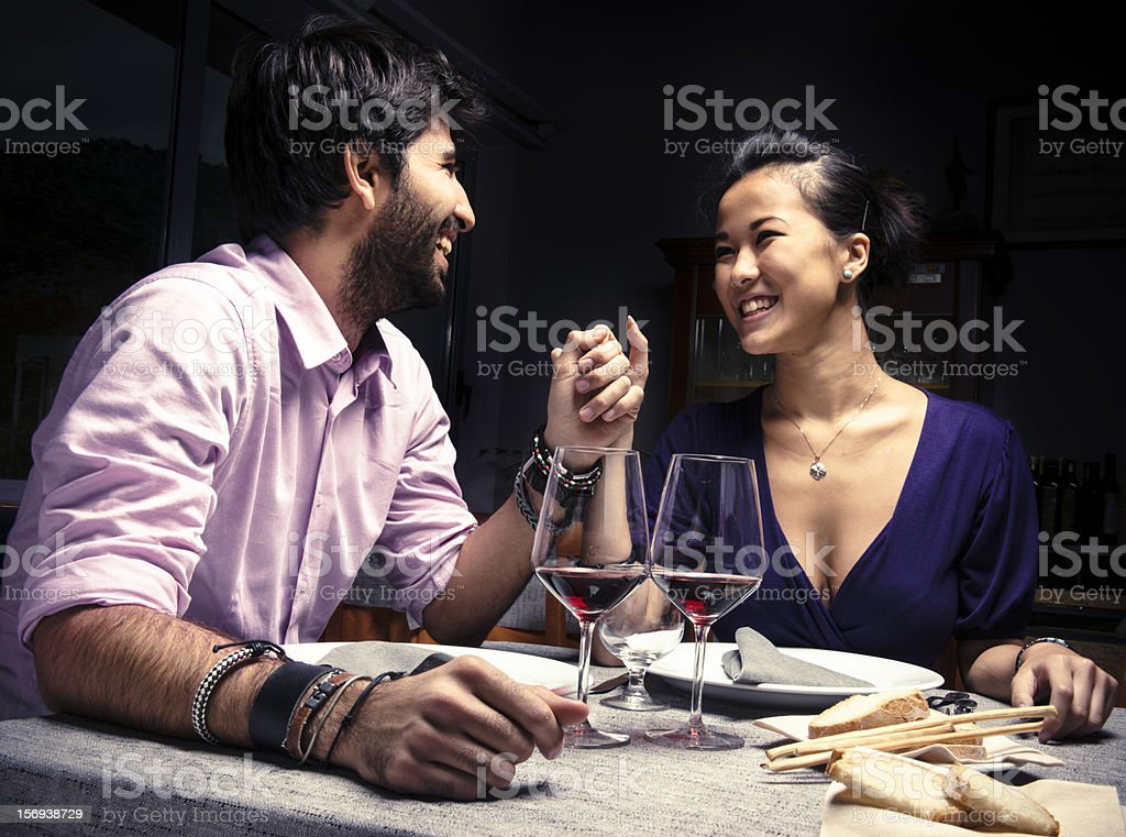 Couple smiling with red wine for St. Valentine stock photo