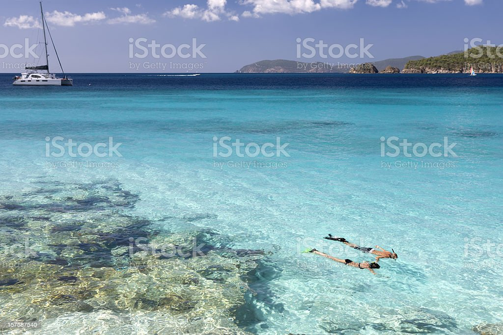 couple snorkeling in the Caribbean crystal clear water stock photo