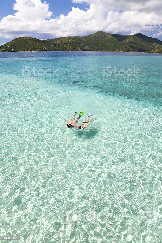 couple snorkeling in the Caribbean crystal clear waters royalty-free stock photo