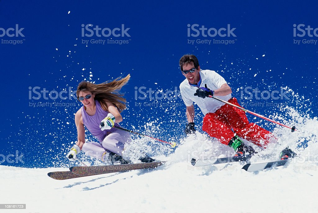 Couple Snow Skiing in Spring royalty-free stock photo