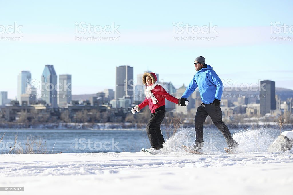 couple snowshoeing in montreal royalty-free stock photo