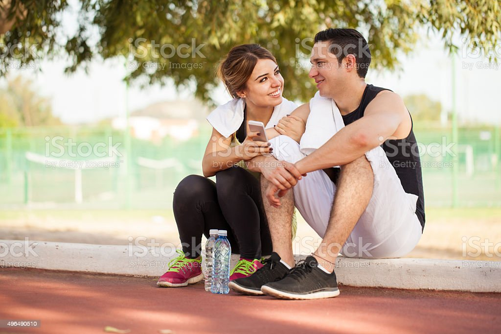 Couple social networking together stock photo