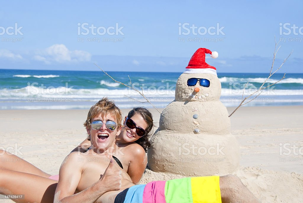 Couple spending christmas time at hot beach stock photo