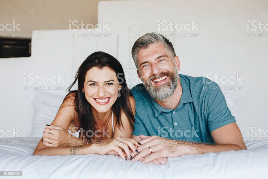 Couple spending their honeymoon in bed - Royalty-free Adult Stock Photo