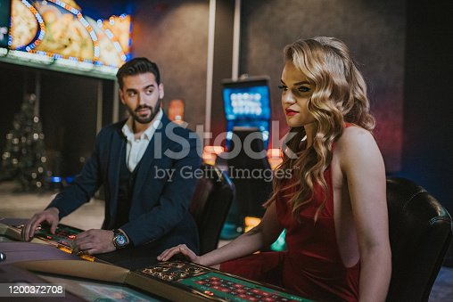 handsome couple having fun and flirting at casino