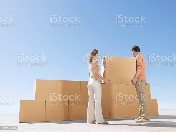 Couple stacking boxes in desert picture id83266096?b=1&k=6&m=83266096&s=612x612&h=5vs7ix8myyzosepgicenvbjlf7zlf7ushtakofwat8q=