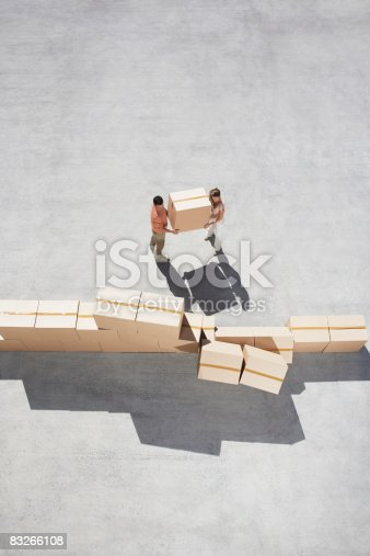 istock Couple stacking boxes 83266108