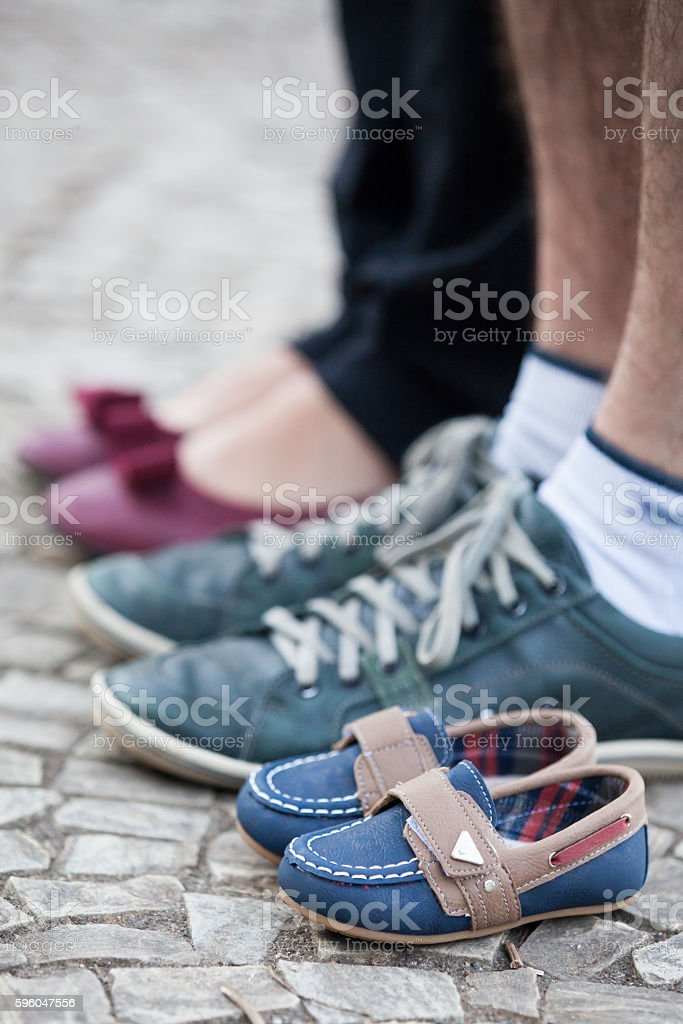 Couple standing along small shoes royalty-free stock photo