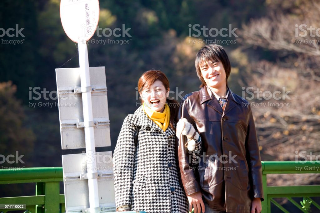 Couple standing at the bus stop royalty-free stock photo