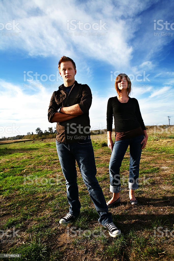 Couple Standing in a Field royalty-free stock photo