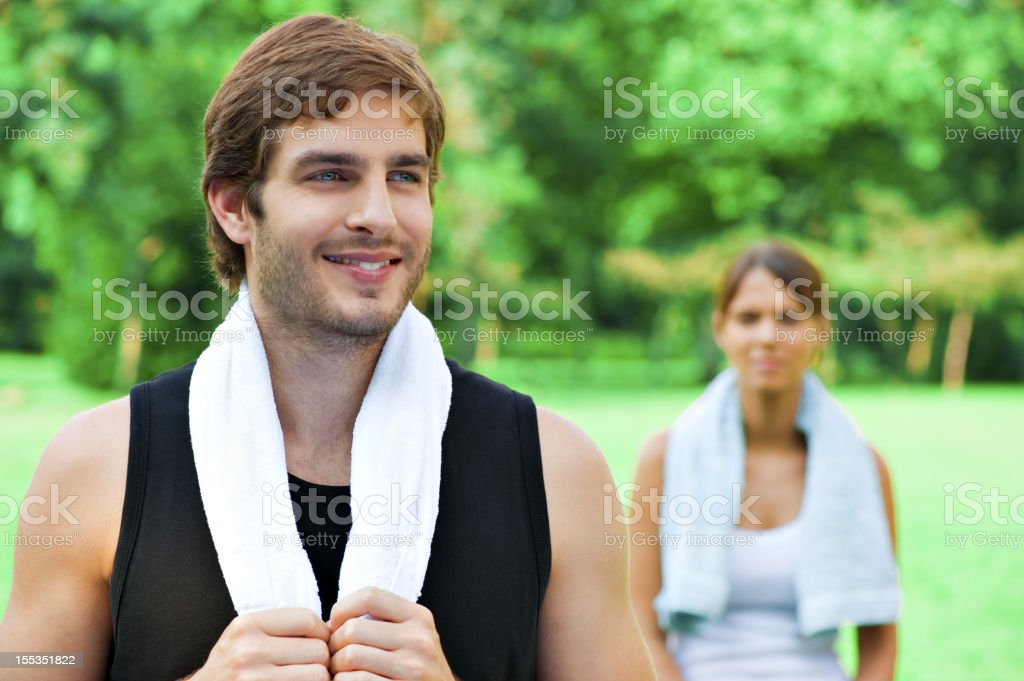 Couple standing in a green meadow stock photo