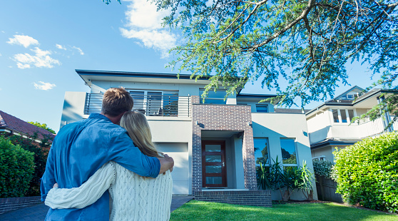 istock Couple standing in front of their new home. 504224016