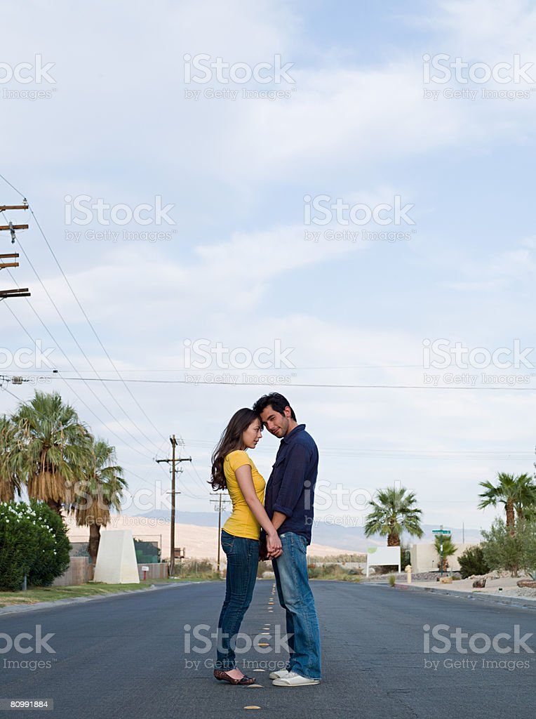 Couple standing in road 免版稅 stock photo