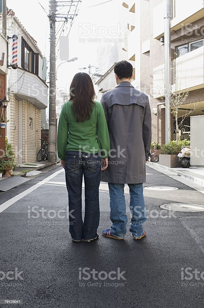 Couple standing in street 免版稅 stock photo