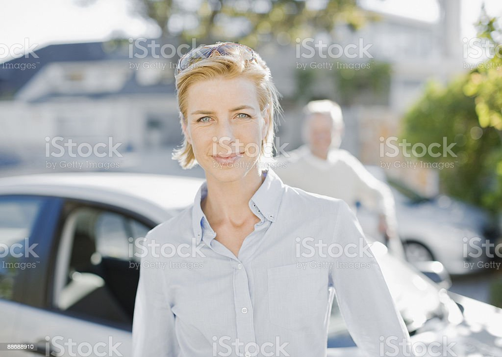 Couple standing near car royalty-free stock photo