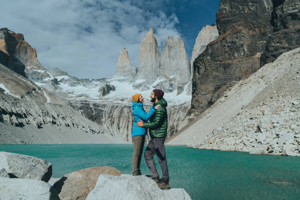 Couple standing on the background of Torres del Paine National Park stock photo