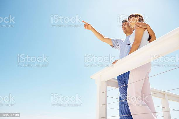 Couple Standing On The Balcony Stock Photo - Download Image Now