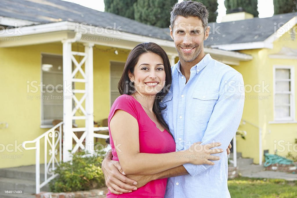 Couple Standing Outside Suburban Home royalty-free stock photo