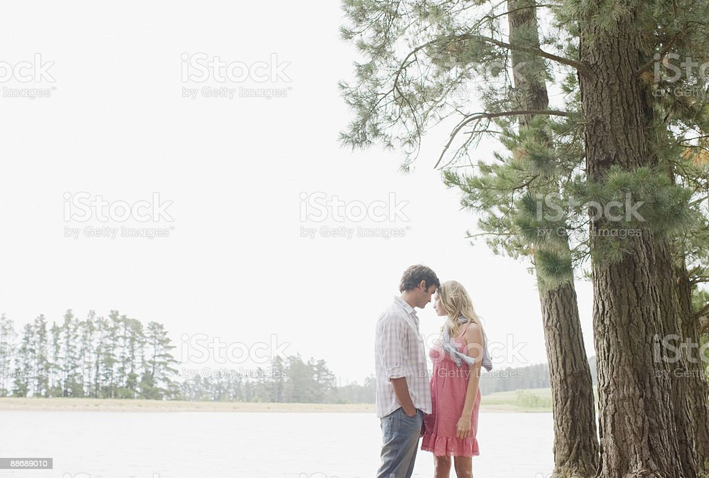 Couple standing together outdoors royalty-free stock photo