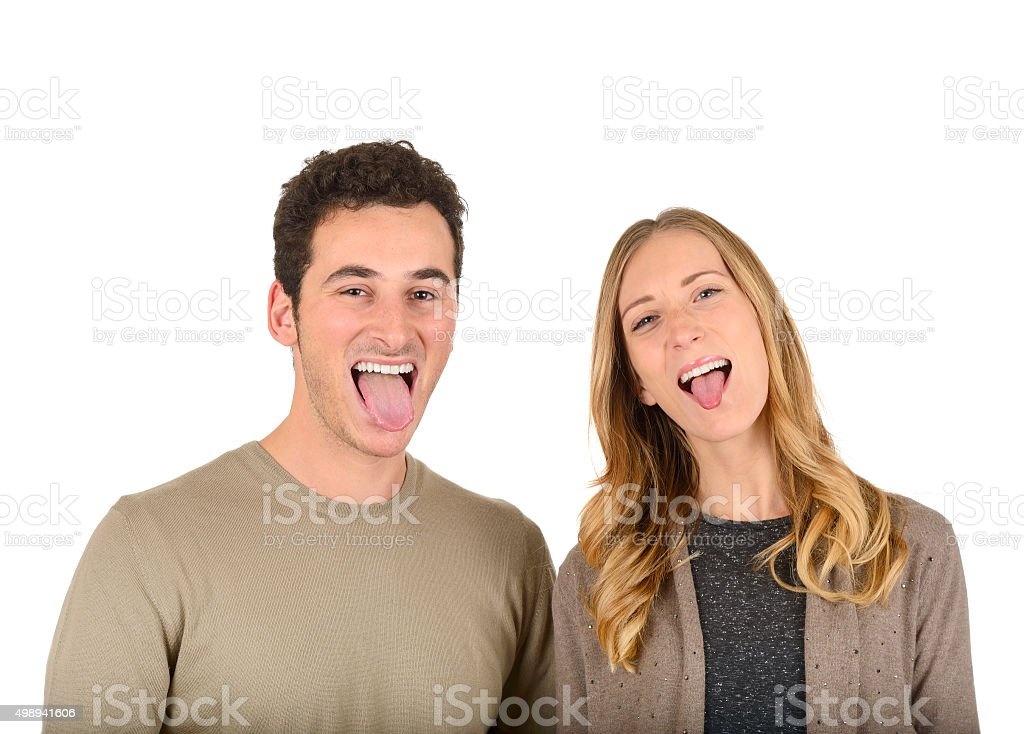 Couple sticking out their tongue stock photo