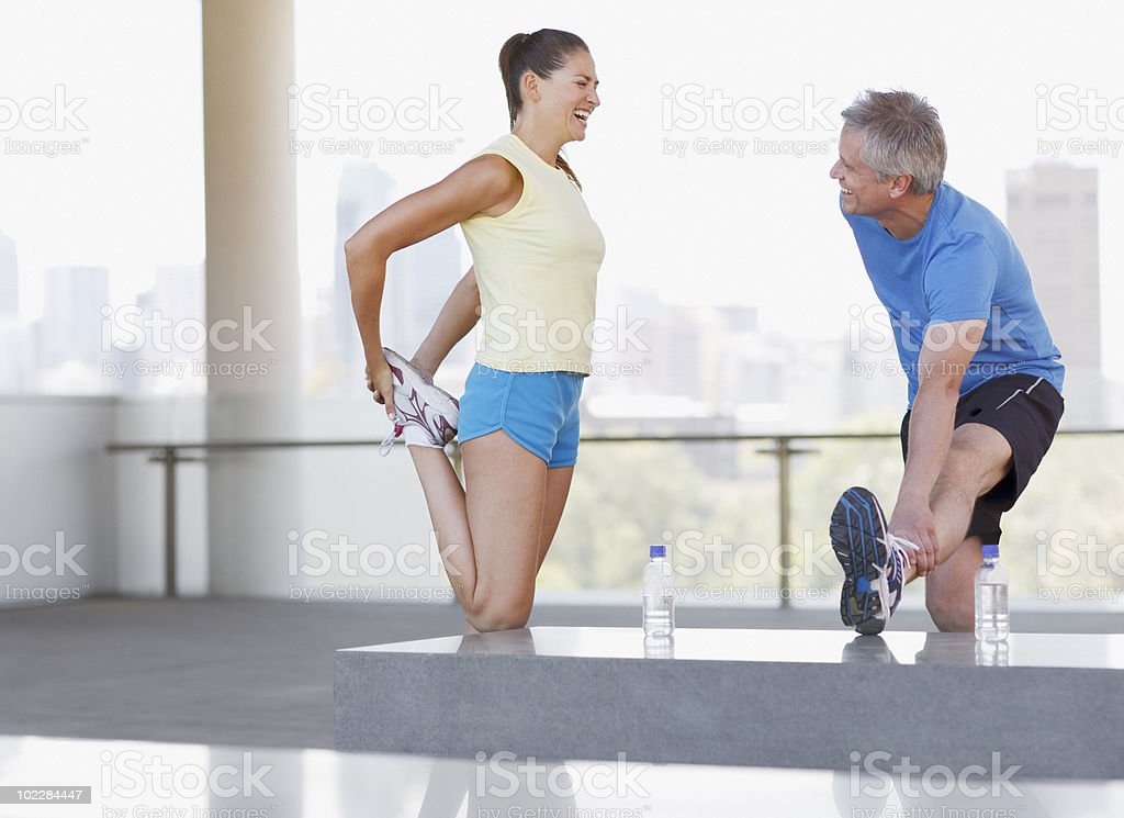 Couple stretching before exercise stock photo