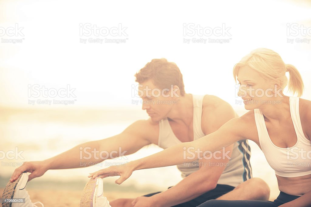 Couple stretching stock photo