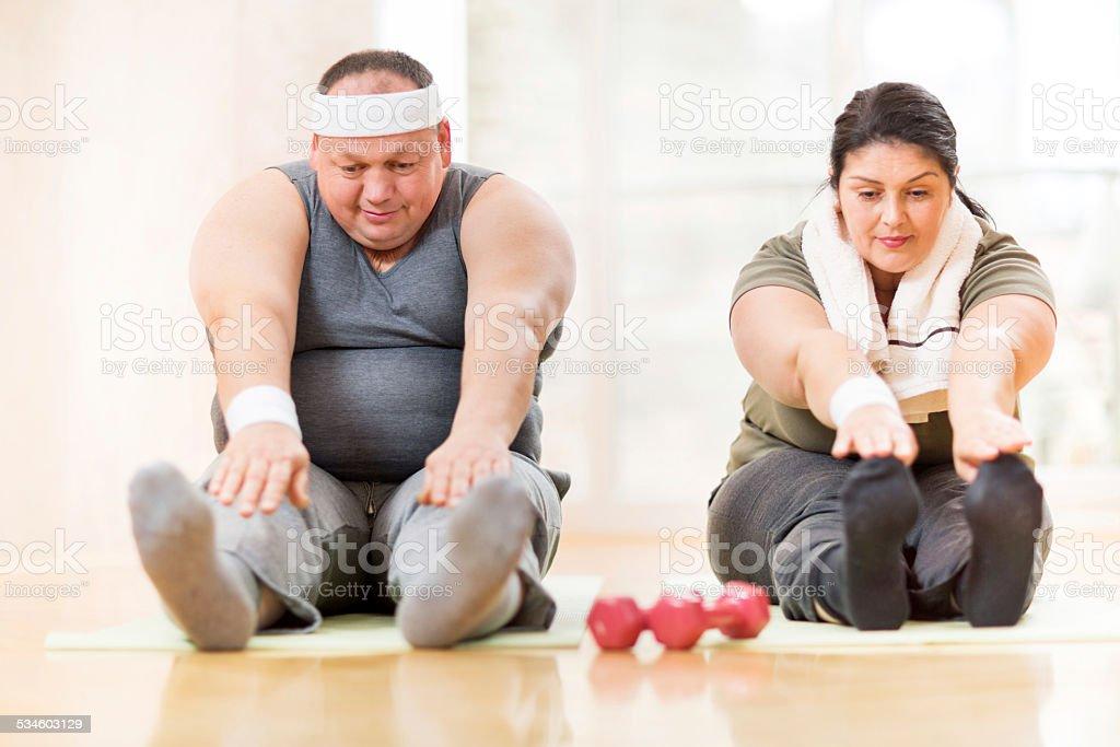 Couple stretching. stock photo