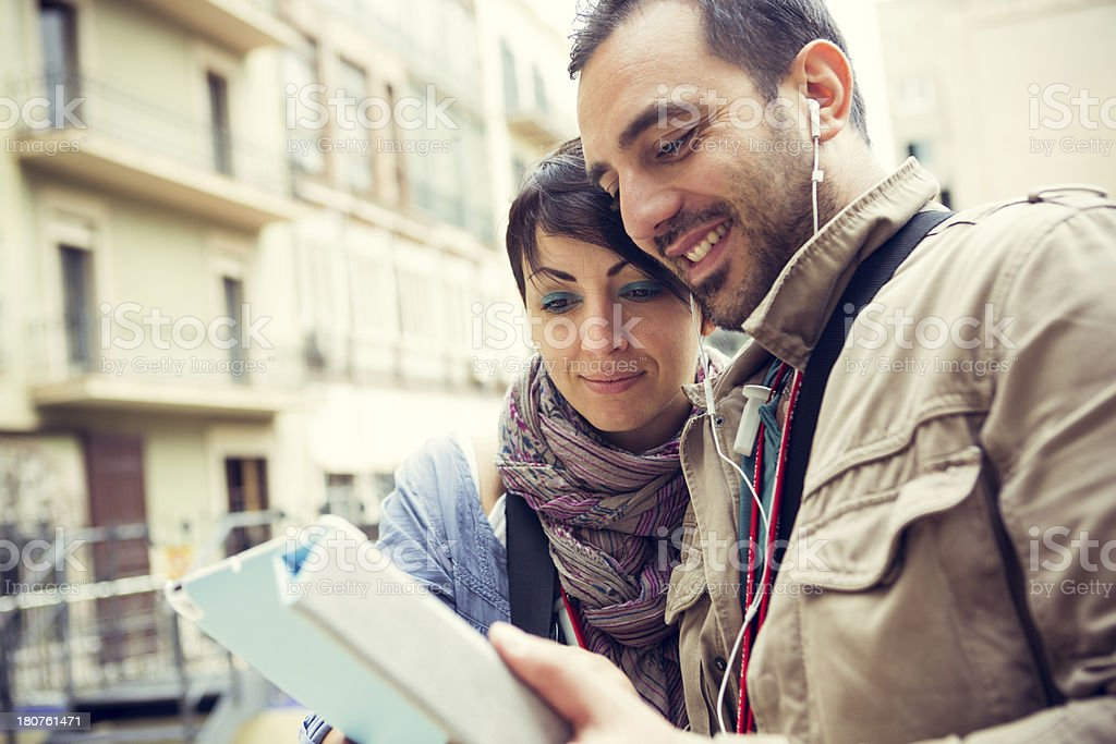 Couple sufing the Web on their Tablet royalty-free stock photo