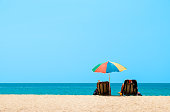 Couple sunbathing and relaxing on beach chairs. Sands and sea view, Summer background - Image