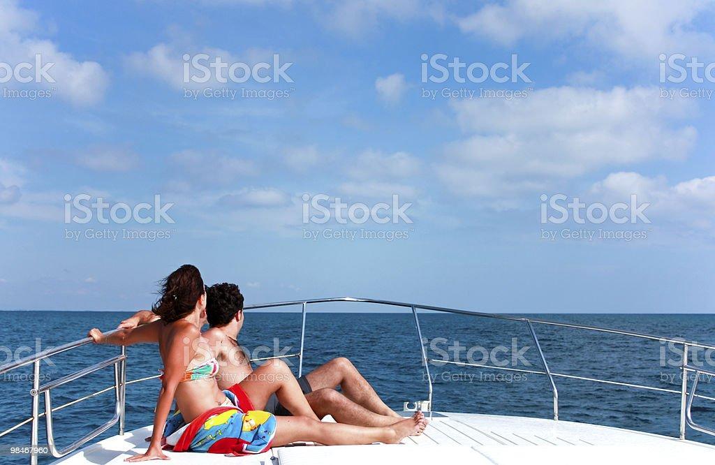 Couple Sunbathing On The Boat royalty-free stock photo