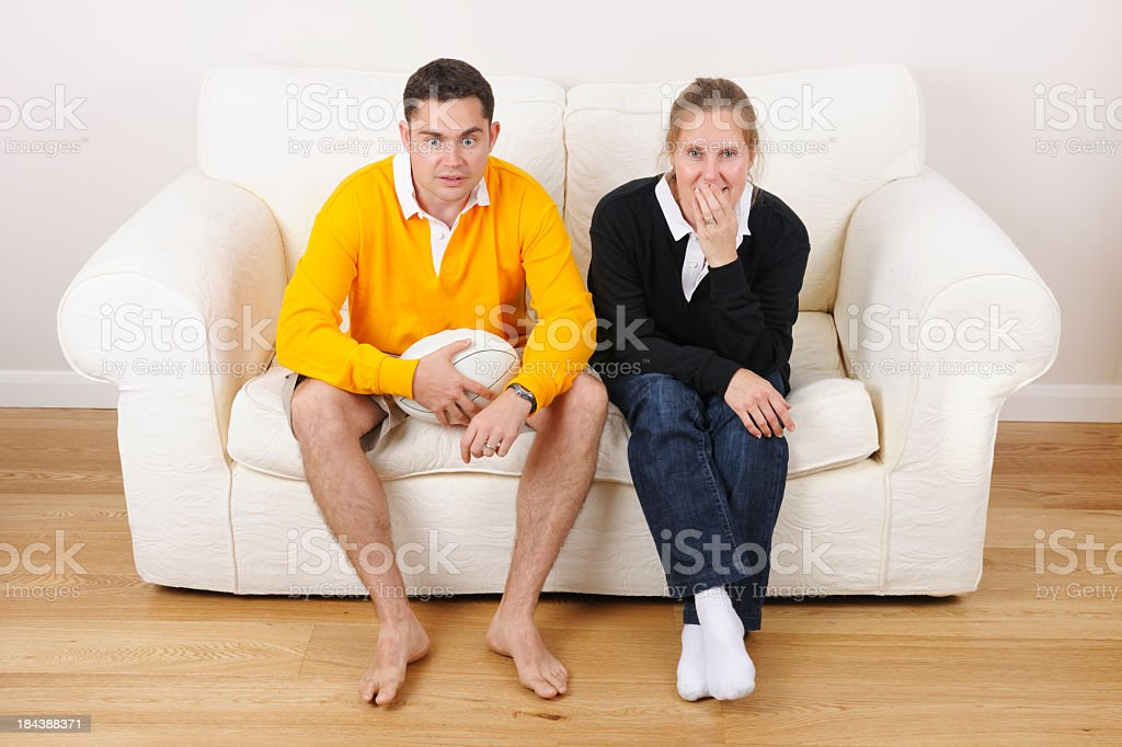 Couple Supporting Opposing Rugby Teams-One  Shocked Another Laughing stock photo