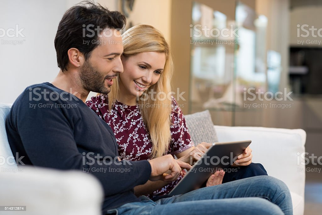 Couple surfing on the web stock photo