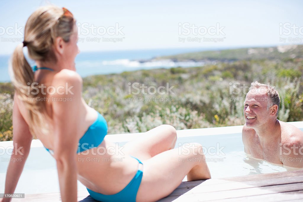 Couple swimming in pool royalty-free stock photo
