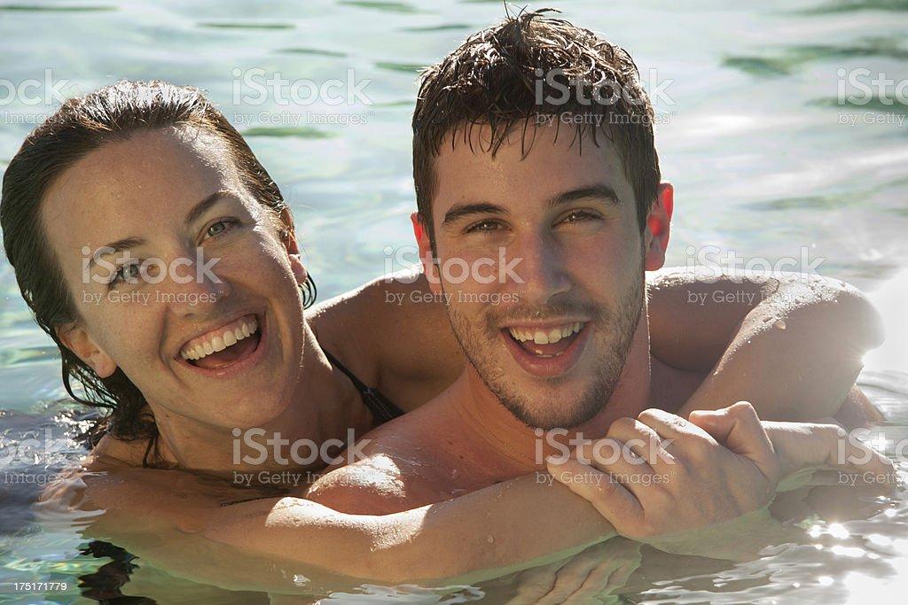 Couple swimming laughing - horizontal royalty-free stock photo