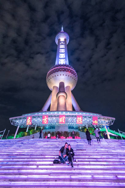 Couple take selfie at The Oriental Pearl tower in Shanghai stock photo