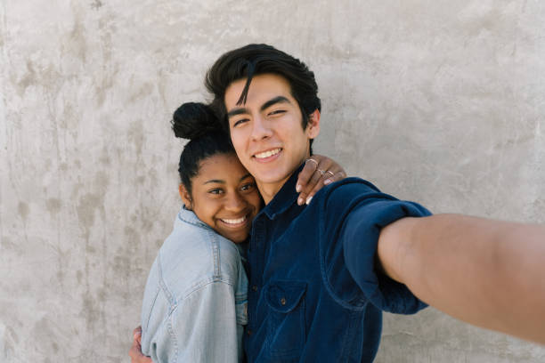 couple takes fun selfie! - two students together asian foto e immagini stock