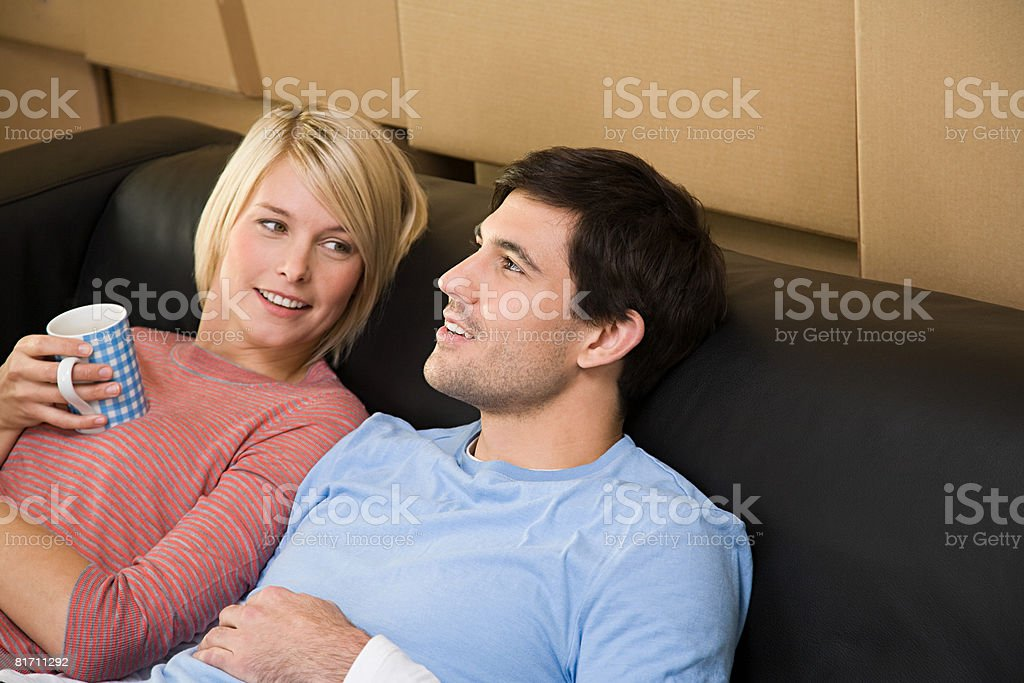 Couple taking a break from moving in royalty-free stock photo