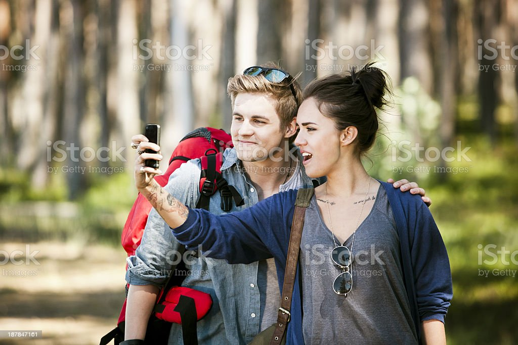 Couple taking a photograph of themself royalty-free stock photo