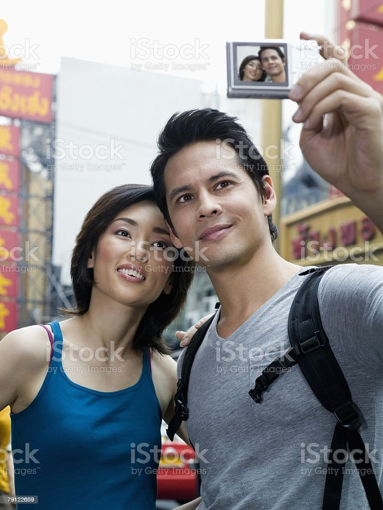 Couple taking a photograph 免版稅 stock photo